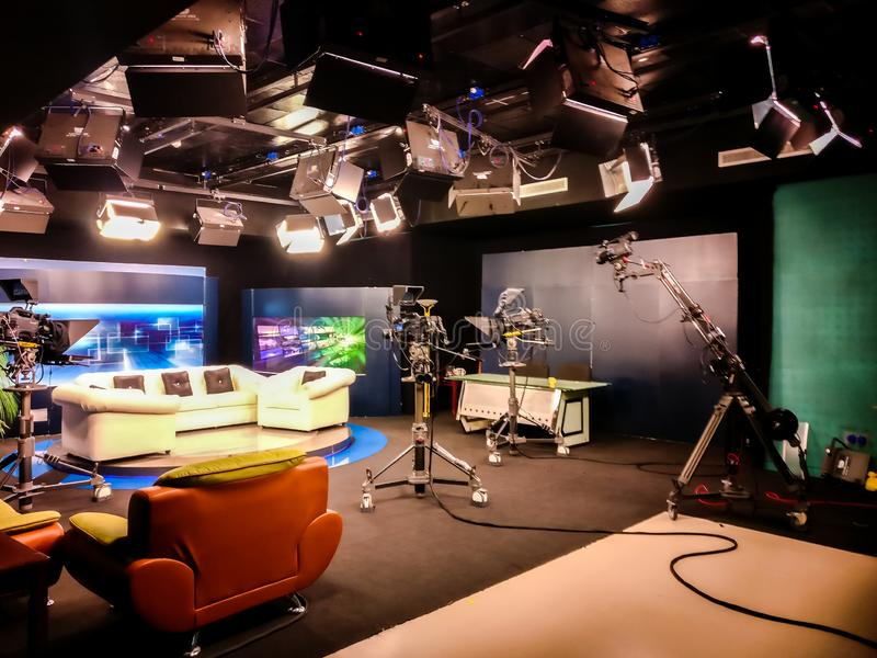 Television studio with camera, lights and coach for interview for recording TV show - University communication collage royalty free stock photo