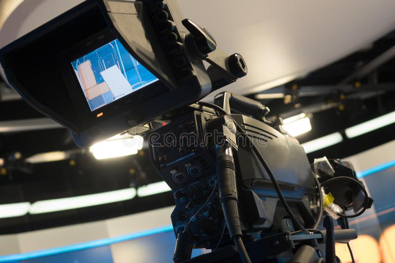 Television studio with camera and lights - recording TV show. Shallow depth of field royalty free stock photography