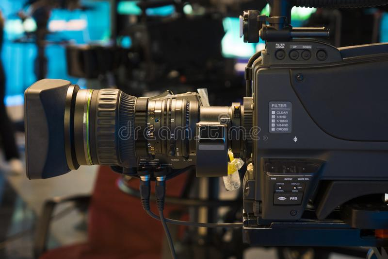 Television studio with camera and lights - recording TV show. Shallow depth of field stock photo
