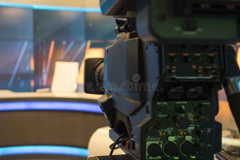 Television studio with camera and lights - recording TV show. Shallow depth of field. Video camera lens recording show in tv studio focus on camera aperture stock photo