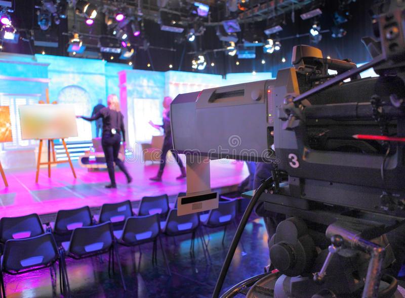 Television studio set and camera. Behind the scenes of a TV television studio with camera and set royalty free stock photos