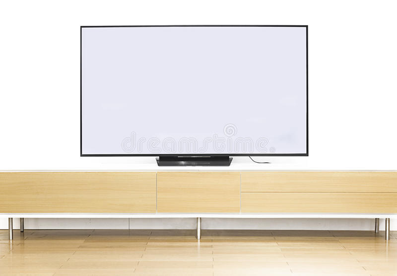 A TELEVISION. IS ON TABLE BEFORE WHITE WALL BACKGROUND IN LIVING ROOM, CHINA stock images