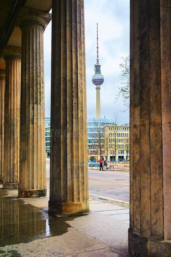 Television tower seen from columns of Old National Gallery Berlin. Berlin, Germany - December 11, 2017: Television tower seen from the columns of the Old royalty free stock photography