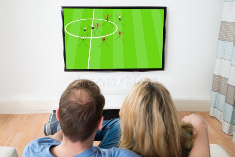 Download Televisione Di Sorveglianza Delle Coppie Immagine Stock - Immagine di signora, svago: 55355493