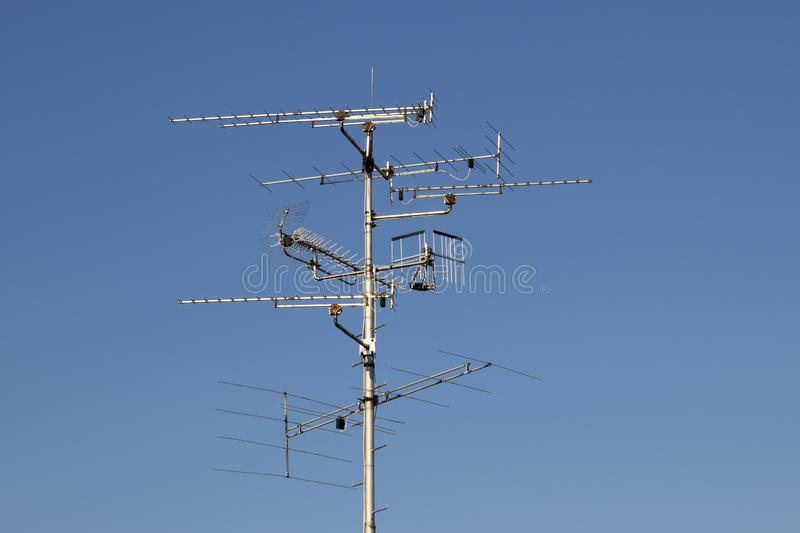 Televisions antennas with blue sky background stock photos