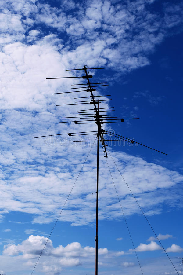 Televisions antennas with cloudy blue sky background stock image
