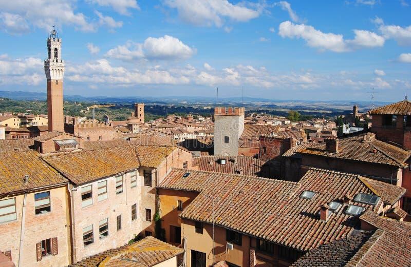 Telhados de Palazzo Comunale e de Siena fotografia de stock royalty free