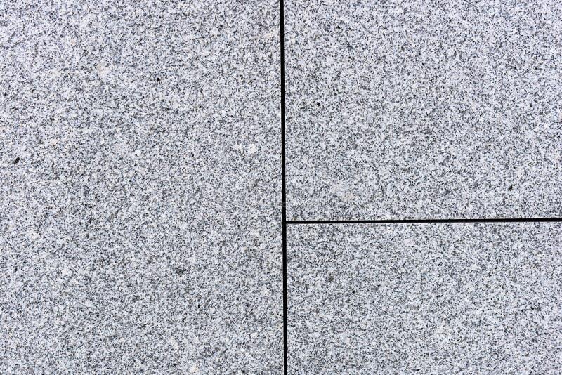 Telhas ou lajes da textura cinzenta e granulado do granito ou do mármore fotografia de stock royalty free