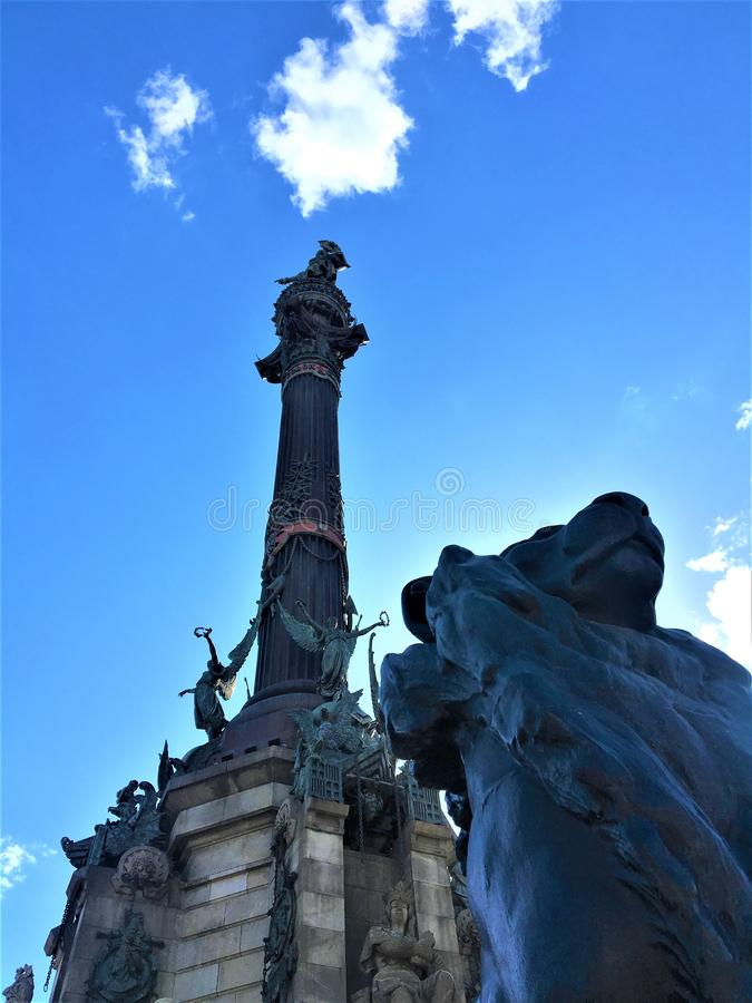 The Columbus Monument and the lion in Barcelona city, Spain. Art, history and elevation stock photos