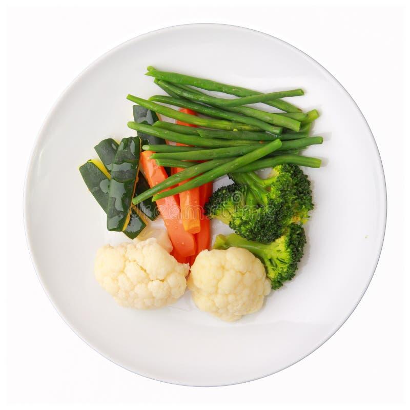 Teller mit gedämpftem Gemüse lizenzfreie stockfotos