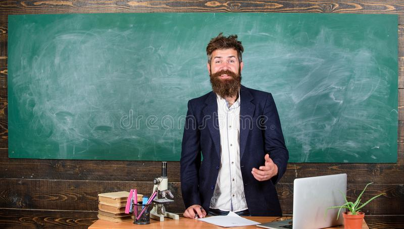 Telling educational stories. Teacher bearded man tell interesting story. Teacher interesting interlocutor best friend. Teacher charismatic hipster stand near stock images