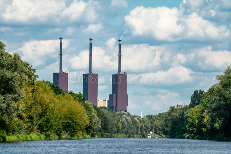 Teltow, Brandenburg, Germany - august 14, 2019: View over the Teltow canal to the Berlin Lichterfelde power station royalty free stock image