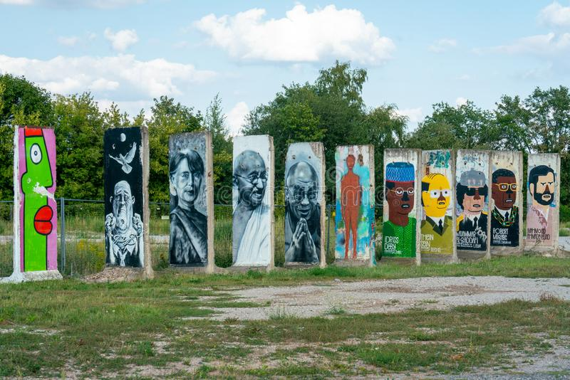 Teltow, Germany -  august 21, 2019: painted segments of the original Berlin wall at the former borderline between west Berlin and royalty free stock photography