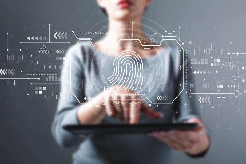 Tema da exploração da impressão digital com a mulher que usa uma tabuleta foto de stock