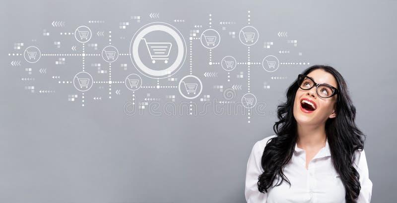 Tema de compra em linha com mulher de negócios nova foto de stock