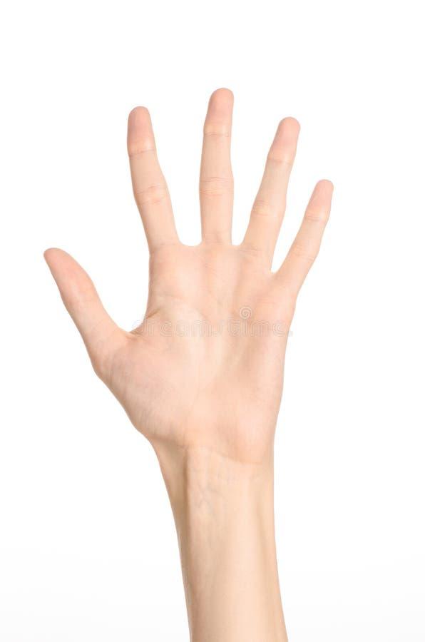 Tema de los gestos de mano: la mano humana muestra gestos aislada en el fondo blanco en estudio imagen de archivo libre de regalías