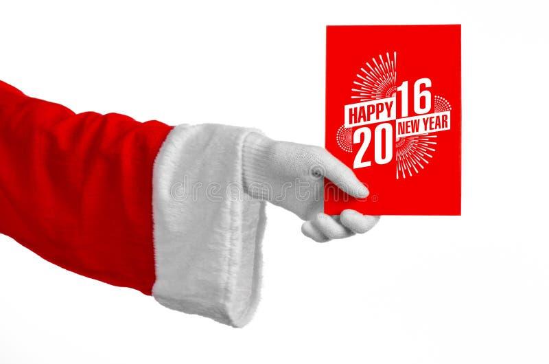 Tema 2016 del nuovo anno e di Natale: Mano di Santa Claus che giudica una carta di regalo rossa su un fondo bianco in studio isol fotografia stock