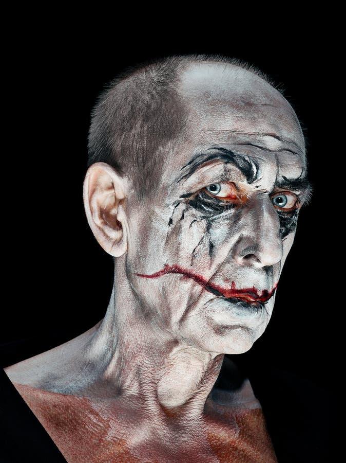 Tema sangriento de Halloween: cara loca del maniak fotografía de archivo