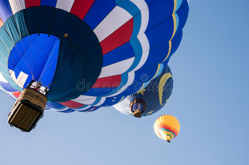 2013 Temecula Balloon and Wine Festival. Colorful hot air balloons in flight over wine country at the Temecula Balloon and Wine Festival royalty free stock images