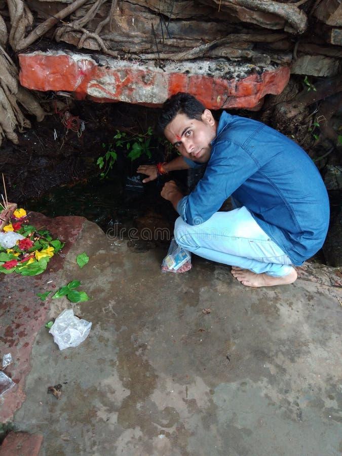 Tempel av Lord ShivaIswara Mahadev med själv för herr Awadhesh royaltyfri bild