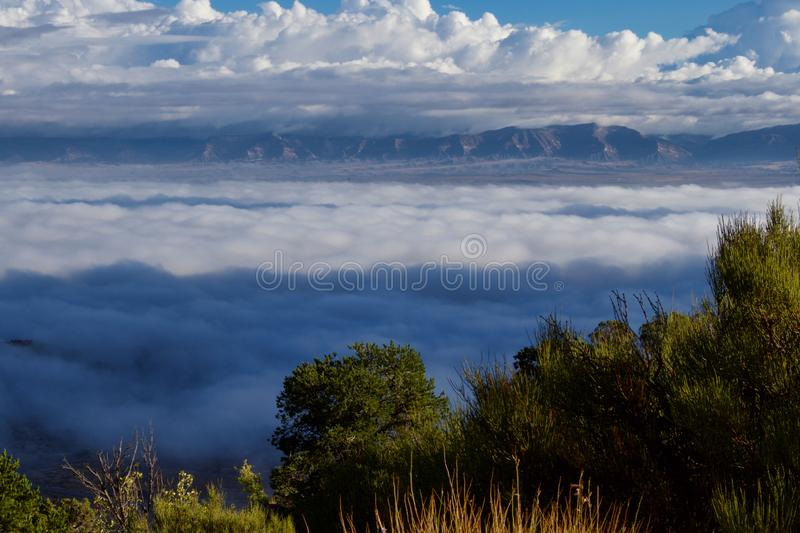 Temperature Inversion in the Grand Valley. View of the Grand Valley from the top of Rimrock Drive. A temperature inversion keeping clouds low in the valley royalty free stock photo
