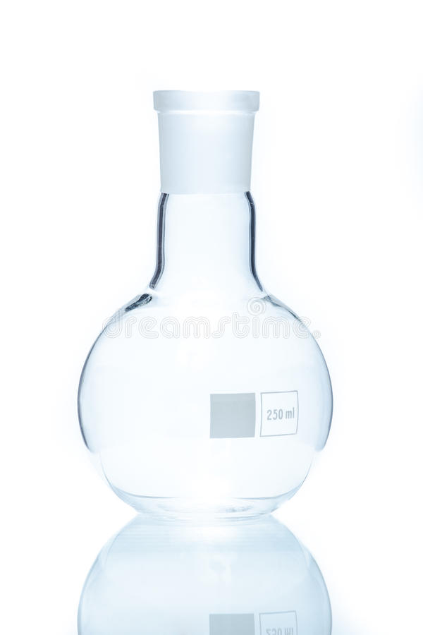 Temperature resistant circular flat-bottom flask for measurement royalty free stock images