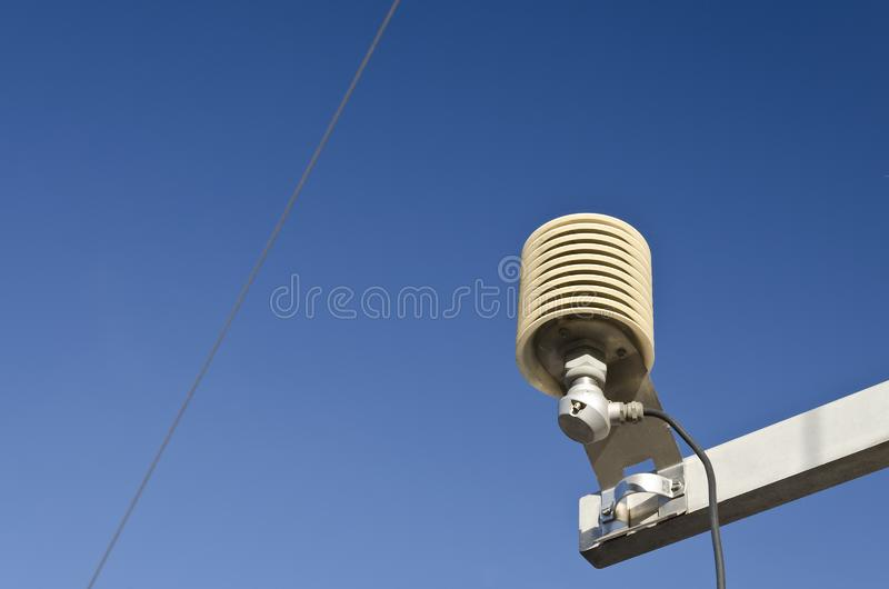 Temperature sensor in a meteo station. On a blue sky royalty free stock image