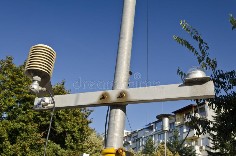 Temperature sensor in a meteo station. On a blue sky stock photo