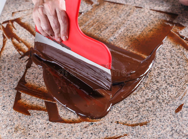 Tempering melted chocolate royalty free stock images