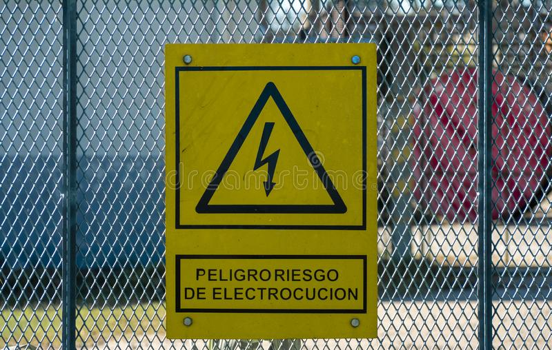 Poster with energy hazard symbol. Temperley, Buenos Aires, Argentina. 19 July 2019. Electricity danger sign at the Temperley railway plant royalty free stock photography