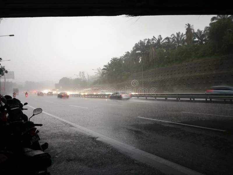 Tempesta di pioggia in Malesia immagini stock libere da diritti