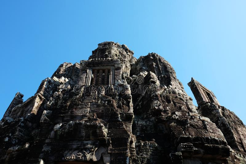 Tempio antico monumentale di Bayon in Cambogia Tempio medievale nell'Indocina Arte architettonica delle civilizzazioni antiche illustrazione vettoriale