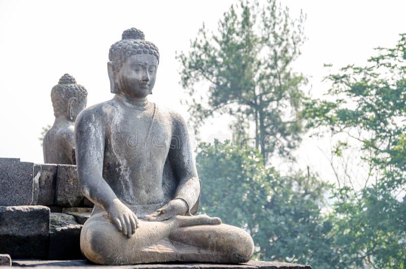 Tempio di Borobudur della statua di Buddha a Yogyakarta, Java, Indonesia immagini stock