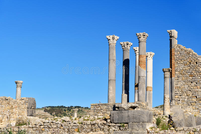 Tempio in rovine romane, città romana antica di Capitoline di Volubilis morocco immagine stock libera da diritti