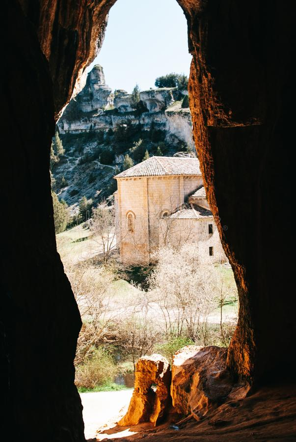 A templar church from a cave. A templar church in a valley viewed from a big cave stock photos