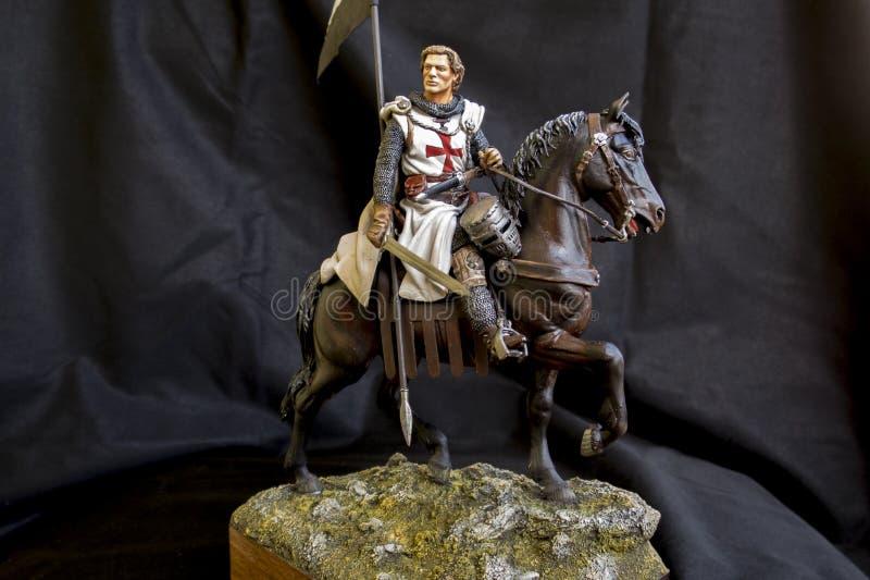 Templar knight. A miniature of a templar knight stock photos