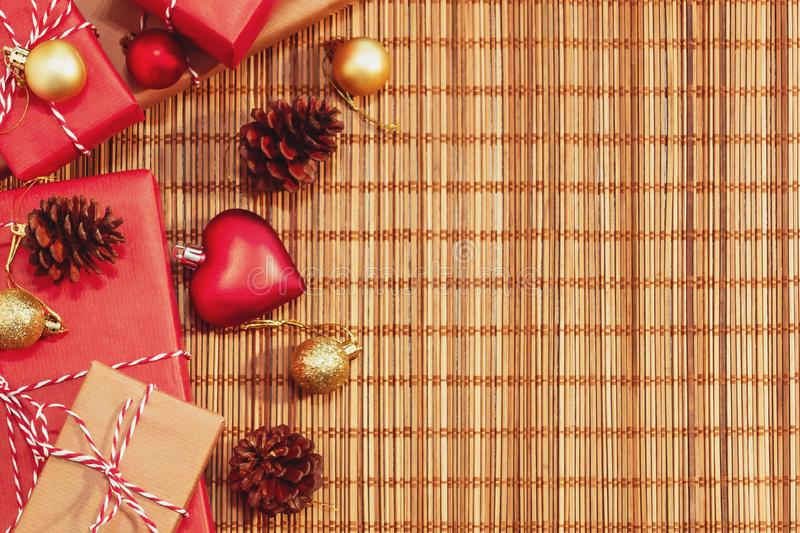 Template for Christmas or New Year card. Wrapped gifts and decorations are laid out on the table. Copy space for text royalty free stock photography
