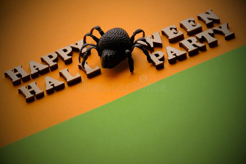 Template for design for the holiday of all saints. Black spider instead of the letter O on a stylish inscription HAPPY HALLOWEEN P. ARTY. Words of wooden letters stock image