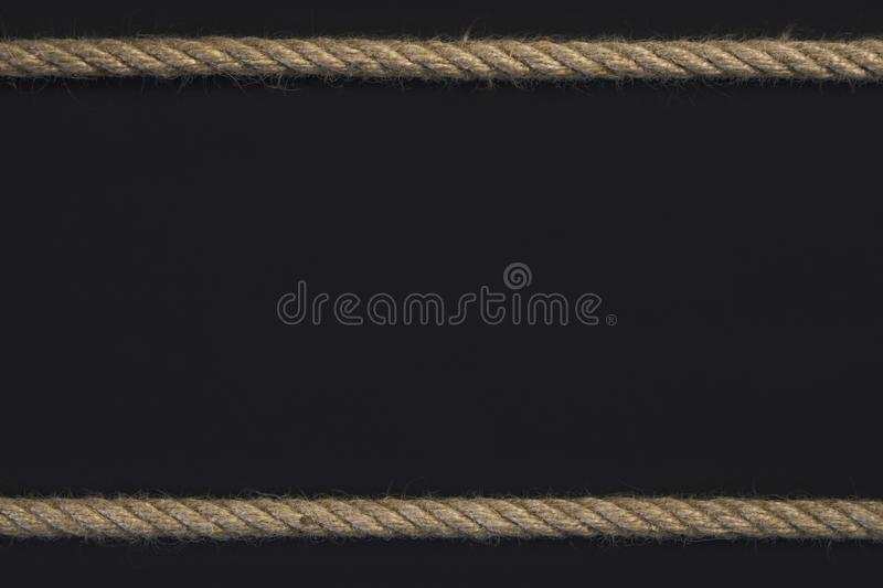Template frame of cord rope on black background.  stock photography