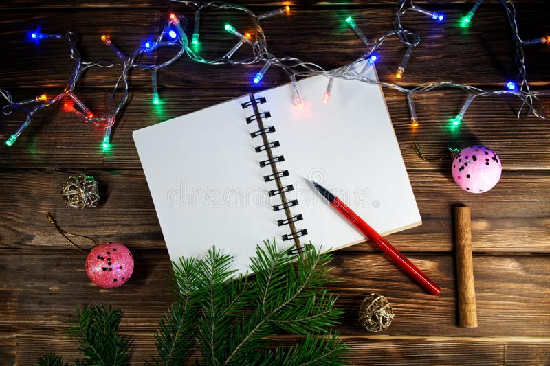 Template letters with New Year and Christmas greetings or a list of gifts. Opened notebook is located at an angle. Happy New Year royalty free stock image