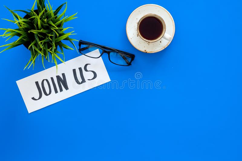 Template for socail media links. Hand lettering Join us on work desk with glasses, coffe, plant on blue background top. View stock images
