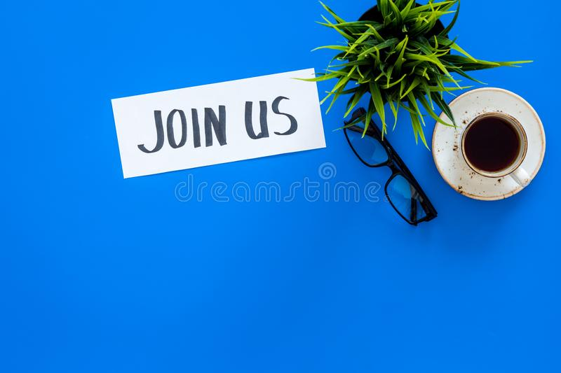 Template for socail media links. Hand lettering Join us on work desk with glasses, coffe, plant on blue background top. View stock photos