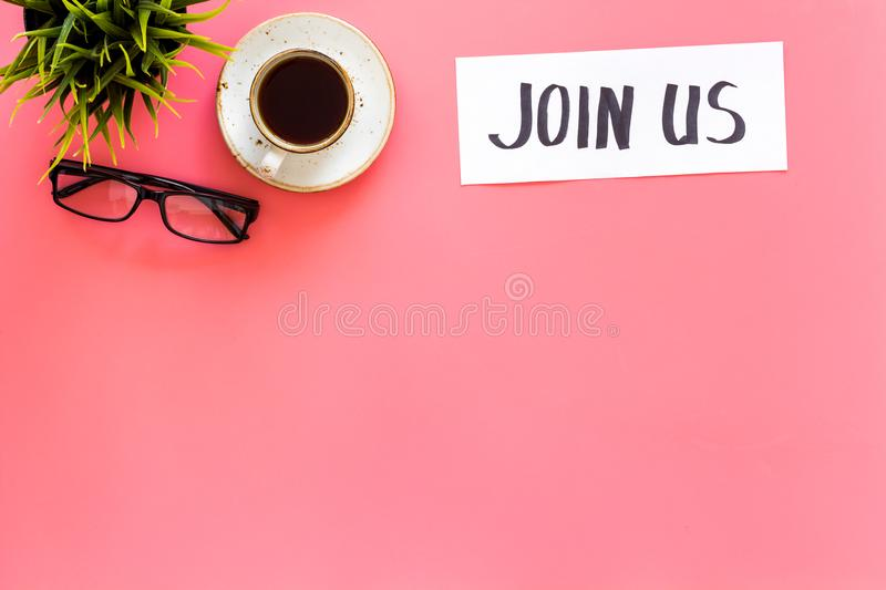 Template for socail media links. Hand lettering Join us on work desk with glasses, coffe, plant on pink background top. View stock photos