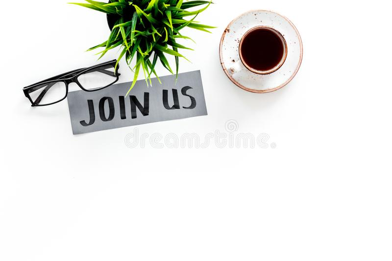 Template for socail media links. Hand lettering Join us on work desk with glasses, coffe, plant on white background top. View stock photos