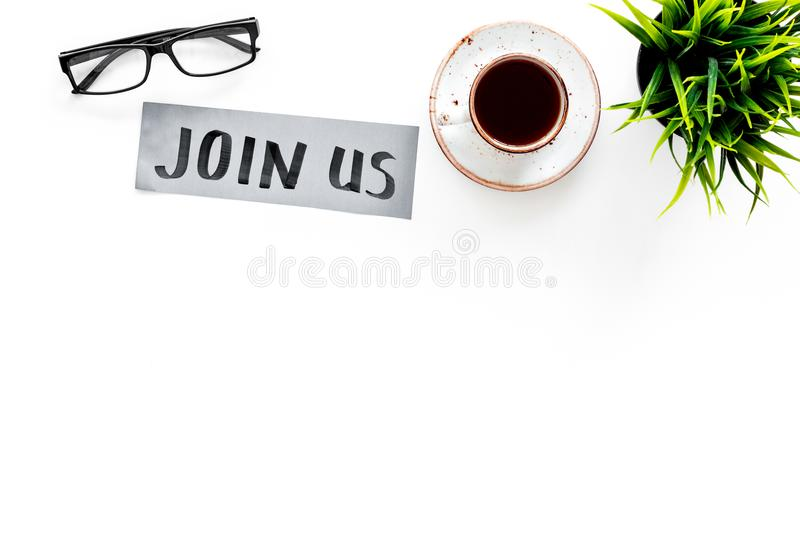 Template for socail media links. Hand lettering Join us on work desk with glasses, coffe, plant on white background top. View royalty free stock photos