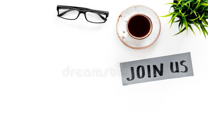 Template for socail media links. Hand lettering Join us on work desk with glasses, coffe, plant on white background top. View royalty free stock image