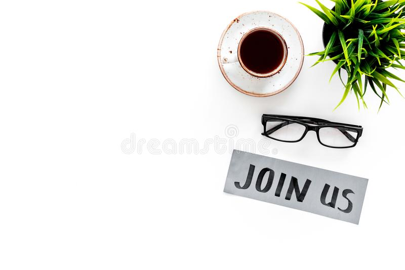 Template for socail media links. Hand lettering Join us on work desk with glasses, coffe, plant on white background top. View stock photo
