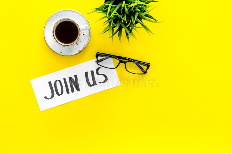 Template for socail media links. Hand lettering Join us on work desk with glasses, coffe, plant on yellow background top. View stock images