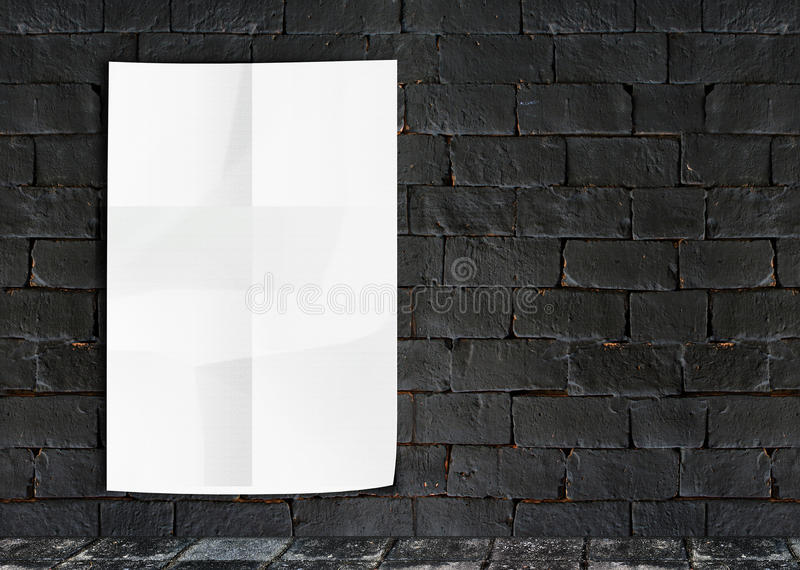 Template- White Crumple Poster on grunge brick wall & footpath g. Template- White Crumple Poster on grunge brick wall royalty free stock photo
