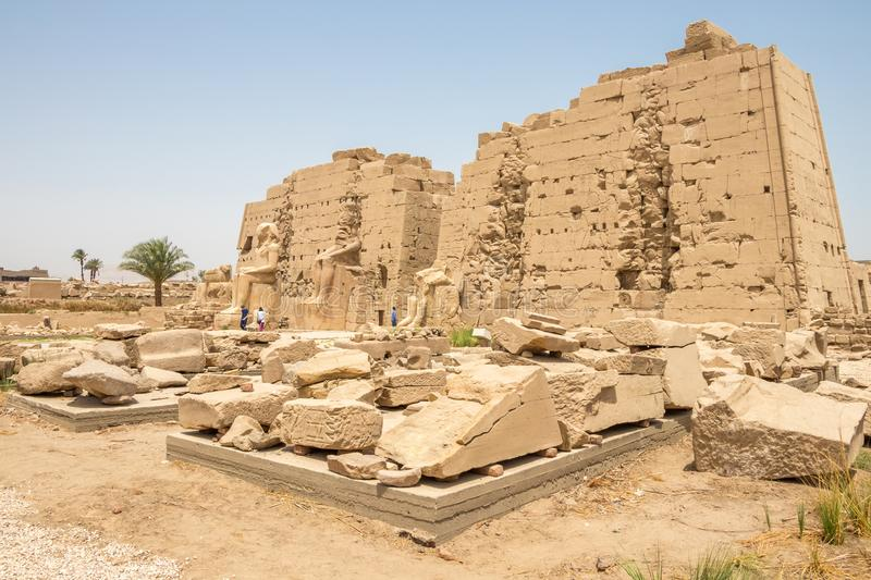 Ancient ruins of Karnak temple in Egypt in spring, Luxor. The Temple of Amun is the largest religious building in the world and honors not only Amun but other stock images